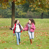 Two pretty girls in the park. Two pretty girls having fun in the park Stock Photo