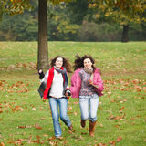 Two pretty girls in the park. Two pretty girls having fun in the park Royalty Free Stock Photo