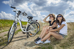 Two pretty girls on path Stock Images