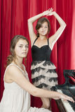 Two pretty girls performing on stage Stock Images