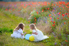 Two pretty girls spending time in the summer park Stock Photo