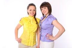 Two pretty girls talk Stock Photos