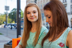 Two pretty girls. They're best friends. Outdoor photo. Stock Photo