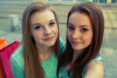 Two pretty girls. They're best friends. Outdoor photo. Royalty Free Stock Images