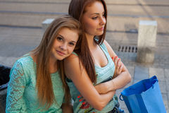 Two pretty girls. They're best friends. Outdoor photo. Stock Photos