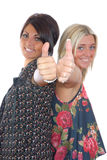 Two pretty girls thumbs up Royalty Free Stock Photos