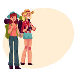 Two pretty girls travelling, hitchhiking with backpacks and camera Stock Images