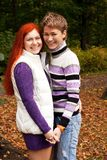 Two pretty girls walking in autumn park Stock Photography