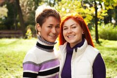 Two pretty girls walking in autumn park Stock Photo