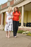 Two pretty girls walking together Royalty Free Stock Images