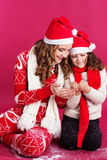Two pretty girls are wearing christmas style Royalty Free Stock Photography