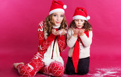 Two pretty girls are wearing christmas style Stock Photo