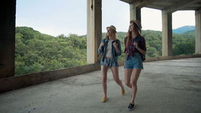Two pretty girls young women friends travelers walk outdoors on mountain scene.  stock video
