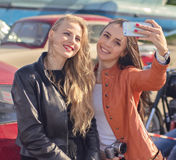 Two pretty hipster girls taking selfie royalty free stock photography
