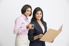 Two pretty Indian Businesswomen Having Informal Meeting Stock Photos
