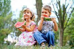 Two pretty kids with watermelon Stock Photos
