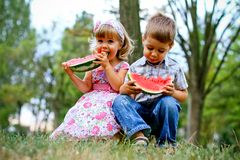 Two pretty kids with watermelon Stock Photo