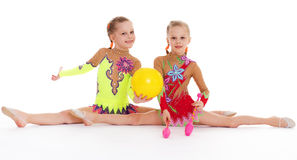 Two pretty little girl doing gymnastics Royalty Free Stock Images