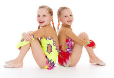 Two pretty little girl doing gymnastics Royalty Free Stock Image