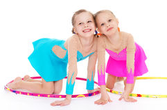 Two pretty little girl doing gymnastics Stock Image