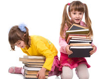 Two pretty little girls with stack of books Royalty Free Stock Photography