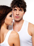 Two pretty lovers. Portrait of a two pretty lovers posing at studio Royalty Free Stock Image