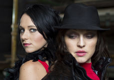 Two pretty mafia ladies back to back Royalty Free Stock Image