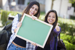 Two Pretty Mixed Race Female Students with Thumbs  Royalty Free Stock Image