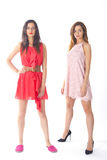 Models in cute dresses. Two pretty models in cute summer dresses royalty free stock photos