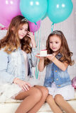 Two pretty sisters with birthday cake Stock Image