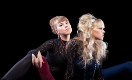 Two pretty sisters posing in lace costume Stock Photography