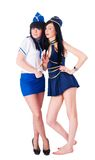 Two pretty stewardess with money Royalty Free Stock Image