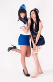 Two pretty stewardess with money Royalty Free Stock Photos