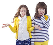 Two pretty surprised teengirls Stock Images