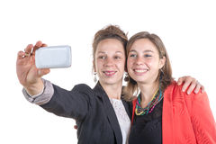 Two pretty teen girls taking selfies with her smart phone Royalty Free Stock Photos