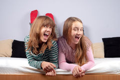 Two pretty teenage girlfriends making funny faces Stock Photos