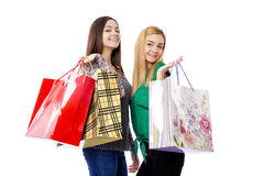 Two pretty teenage girls holding shopping bags Stock Image