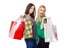 Two pretty teenage girls holding shopping bags Stock Photos