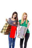 Two pretty teenage girls looking in their shopping bags Stock Photography