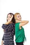 Two pretty teenage girls  posing and making ok sign. Over white background Royalty Free Stock Images