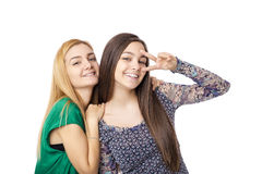 Two pretty teenage girls  posing and showing two fingers Stock Images