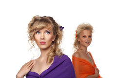 Two pretty woman with flowers in hairs Royalty Free Stock Images