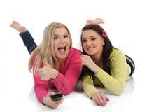 Two pretty woman friends watching television Royalty Free Stock Photo