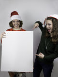 Two pretty woman holding sign Stock Photo