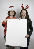 Two pretty woman holding signs Royalty Free Stock Photo