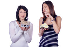 Two pretty woman with miniature house Stock Images
