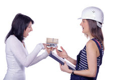 Two pretty woman with miniature house Stock Photography
