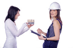Two pretty woman with miniature house Stock Photo
