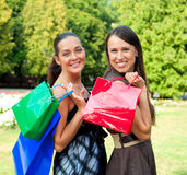 Two pretty women with bags Stock Images