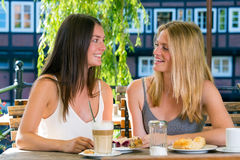 Two pretty women in cafe Stock Photography